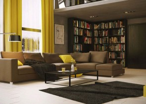 Michal-Skitomek-living-with-library-and-yellow-accents