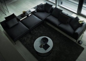 black-leather-sectional-sofa-1-600x373